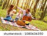 happy couple enjoying picnic... | Shutterstock . vector #1080636350