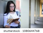 girl student on the street with ... | Shutterstock . vector #1080644768