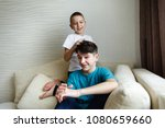 the younger brother plays with... | Shutterstock . vector #1080659660