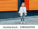 pretty blonde girl in white... | Shutterstock . vector #1080660500