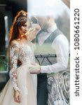 the bridegroom embraces the... | Shutterstock . vector #1080661220