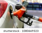 to fill the machine with fuel | Shutterstock . vector #1080669323