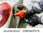 man is  filling the machine... | Shutterstock . vector #1080669476
