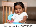 a surprised little girl holding ... | Shutterstock . vector #108071903