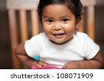 excited baby girl holding a... | Shutterstock . vector #108071909