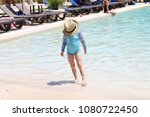 girl with a straw hat in a pool ... | Shutterstock . vector #1080722450