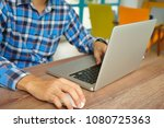 hand of young man using laptop... | Shutterstock . vector #1080725363