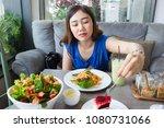 Asian Women Enjoying Eating A...