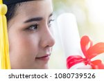 happy graduate young asian... | Shutterstock . vector #1080739526