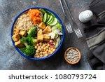 colorful buddha bowl on dark... | Shutterstock . vector #1080793724