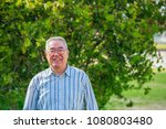 outdoor asian senior male | Shutterstock . vector #1080803480