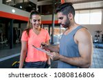 fitness instructor checking the ... | Shutterstock . vector #1080816806
