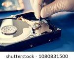 closeup of hands with tweezers...   Shutterstock . vector #1080831500