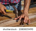 man feeling his sore hand after ... | Shutterstock . vector #1080835490