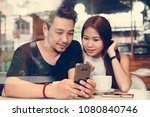 couple using a phone at a cafe | Shutterstock . vector #1080840746