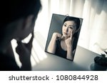 woman who is shocked by seeing... | Shutterstock . vector #1080844928