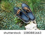 blue loafers with brown laces.... | Shutterstock . vector #1080881663