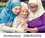 islamic women friends looking... | Shutterstock . vector #1080942503