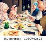 islamic women friends dining... | Shutterstock . vector #1080942623