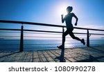 sporty fitness female runner... | Shutterstock . vector #1080990278