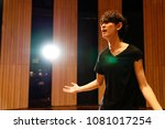 Small photo of Young actor in a theater.