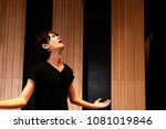 young actor in a theater. | Shutterstock . vector #1081019846