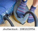 a woman with air foot pump... | Shutterstock . vector #1081023956