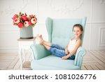 little girl is sitting on a... | Shutterstock . vector #1081026776