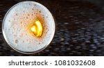 glass of beer on a dark... | Shutterstock . vector #1081032608