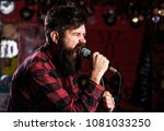 brutal bearded singer with... | Shutterstock . vector #1081033250