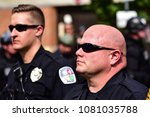 Small photo of July 8, 2017 Charlottesville, Virginia USA Charlottesville City Police call unlawful assembly trying secure jail parking garage entrance as protesters try to block exit as KKK attempt to leave.