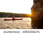 young woman paddling the red... | Shutterstock . vector #1081036676