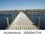 a fishing pier stands ready for ... | Shutterstock . vector #1081041734