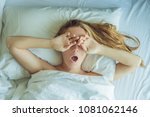 beautiful young woman lying... | Shutterstock . vector #1081062146