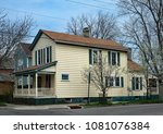 old yellow house with spindled... | Shutterstock . vector #1081076384