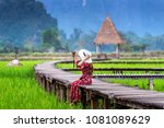 young woman sitting on wooden... | Shutterstock . vector #1081089629