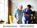 nurse helping senior woman to... | Shutterstock . vector #1081116353