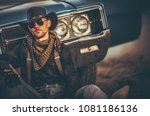 The Men of the Far West. Caucasian Western Wear Men in His 30s Relaxing in Front of His Classic Muscle Car. American West. - stock photo