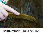 to comb the hair  comb | Shutterstock . vector #1081200464