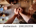 male potter molding a clay in...   Shutterstock . vector #1081202558