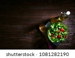fresh mixed green salad in bowl ... | Shutterstock . vector #1081282190