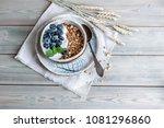muesli or granola in a bowl... | Shutterstock . vector #1081296860