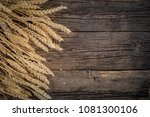 wheat ears on rustic wooden... | Shutterstock . vector #1081300106