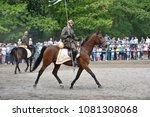 Small photo of WARSAW, POLAND - MAY 01, 2018: Polish cavalryman (uhlan) of 1930s with a spear, closeup. Cavalry show in Royal Lazienki park during Labor day celebration.