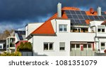 solar panels on a red tile roof.... | Shutterstock . vector #1081351079