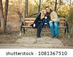 family of three people sitting... | Shutterstock . vector #1081367510