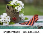 Small photo of garrison cap, apple blossom, George ribbon are symbol of Victory day