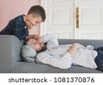 smiling boy wakes up a father... | Shutterstock . vector #1081370876