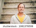 outdoor portrait of 50 year old ...   Shutterstock . vector #1081378508
