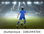 back view of asian footballer... | Shutterstock . vector #1081494704